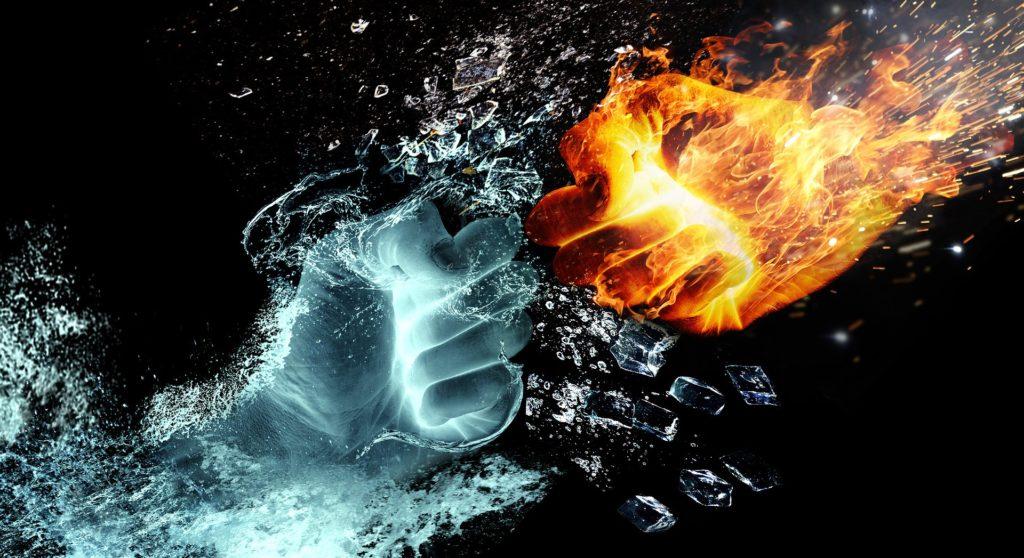 火と水の拳がぶつかりあっている